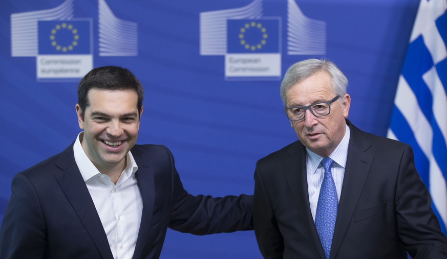 epa04813734 Greece's Prime Minister Alexis Tsipras (L) is welcomed by European Commission President Jean-Claude Juncker ahead of an emergency leaders summit on Greece at the European Commission in Brussels, Belgium, 22 June 2015. Progress has been made on Greece over the weekend, but 'we are not yet there,' European Commission President Jean-Claude Juncker said ahead of a meeting with Greek Prime Minister Alexis Tsipras. Tsipras, meanwhile, said 'this is time for a substantial and viable solution that would allow Greece to come back to growth, within the eurozone, and with social justice.'  EPA/OLIVIER HOSLET