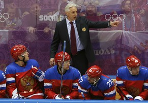 Russia's head coach Zinetula Bilyaletdinov talks to Russia's Alexander Ovechkin (L) during the third period of their men's preliminary round ice hockey game against Slovakia at the Sochi 2014 Winter Olympic Games February 16, 2014. REUTERS/Grigory Dukor (RUSSIA  - Tags: SPORT ICE HOCKEY OLYMPICS)