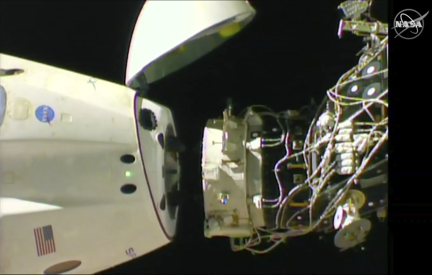 In this image taken from NASA Television, SpaceX's swanky new crew capsule undocks from the International Space Station Friday, March 8, 2019. The capsule undocked and is headed toward an old-fashioned splashdown. The Dragon capsule pulled away from the orbiting lab early Friday, a test dummy named Ripley its lone occupant. (NASA TV via AP)