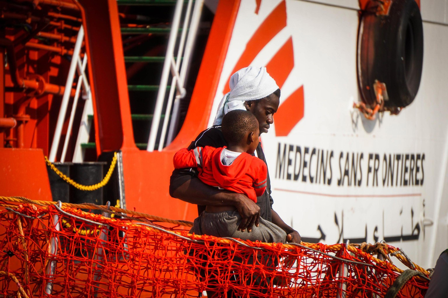 epa06086316 Migrants disembark from the humanitarian 'Vos Prudence' ship of Doctors Without Borders (Medecins Sans Frontieres, MSF) at Molo Manfredi quay, in Salerno's main harbour, Campania Region, southern Italy, 14 July 2017. The ship docked in the port of Salerno carrying 935 migrants - 793 men, 125 women, seven of whom are pregnant and 16 children, including two infants - media reported.  EPA/CESARE ABBATE