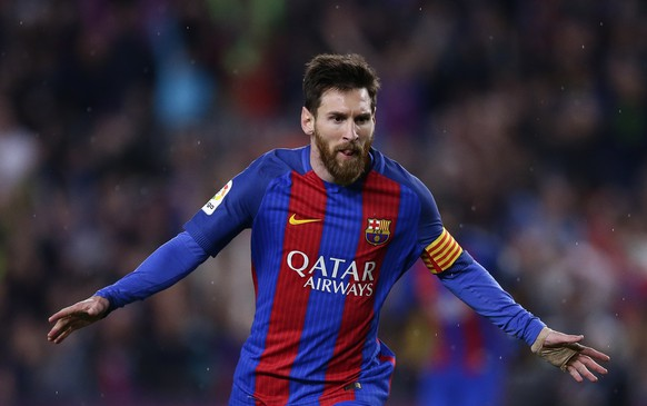 FC Barcelona's Lionel Messi celebrates after scoring during the Spanish La Liga soccer match between FC Barcelona and Real Sociedad at the Camp Nou stadium in Barcelona, Spain, Saturday, April 15, 2017. (AP Photo/Manu Fernandez)