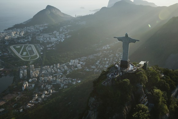 RIO DE JANEIRO, BRAZIL - FEBRUARY 24: The famed Christ the Redeemer statue is seen atop Corcovado mountain in an aerial view on February 24, 2015 in Rio de Janeiro, Brazil. The Art Deco statue is 38 meters tall and was inaugurated in 1931. Rio marks its 450th anniversary on March 1st and is celebrating the event with a yearlong series of events including concerts, exhibitions, historical tours, soccer matches, fireworks displays and other activities. The 'Marvelous City' was founded in 1565 by the Portuguese and was the seat of power of the Portuguese Empire in the 19th century before serving as the capital of the Brazilian Republic until 1960. The city is BrazilÕs most popular tourist destination and will host the Rio 2016 Olympic Games, the first to be held in South America, next year. (Photo by Mario Tama/Getty Images)