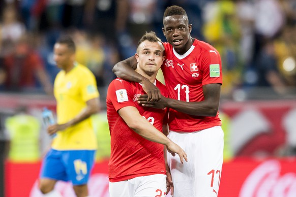 Switzerland's midfielder Xherdan Shaqiri, left, and Switzerland's midfielder Denis Zakaria, right, react during the FIFA soccer World Cup 2018 group E match between Switzerland and Brazil at the Rostov Arena, in Rostov-on-Don, Russia, Sunday, June 17, 2018. (KEYSTONE/Laurent Gillieron)