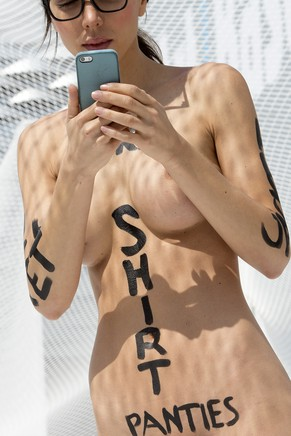 Swiss performance artist Milo Moire walks naked on the exhibition site of the international art show Art Basel, in Basel, Switzerland, on Thursday, June 19, 2014. Controversial Swiss artist Milo Moire names her Performance to walk naked through the Art Basel exhibition