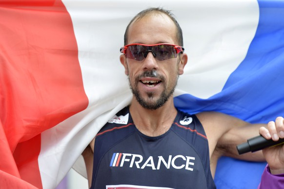 Yohann Diniz from France celebrates after breaking the World Record as he wins the gold medal in the men's 50km race walking in the city centre of Zurich at the fourth day of the European Athletics Championships in Zurich, Switzerland, Friday, Aug. 15, 2014. (AP Photo/Keystone, Walter Bieri)