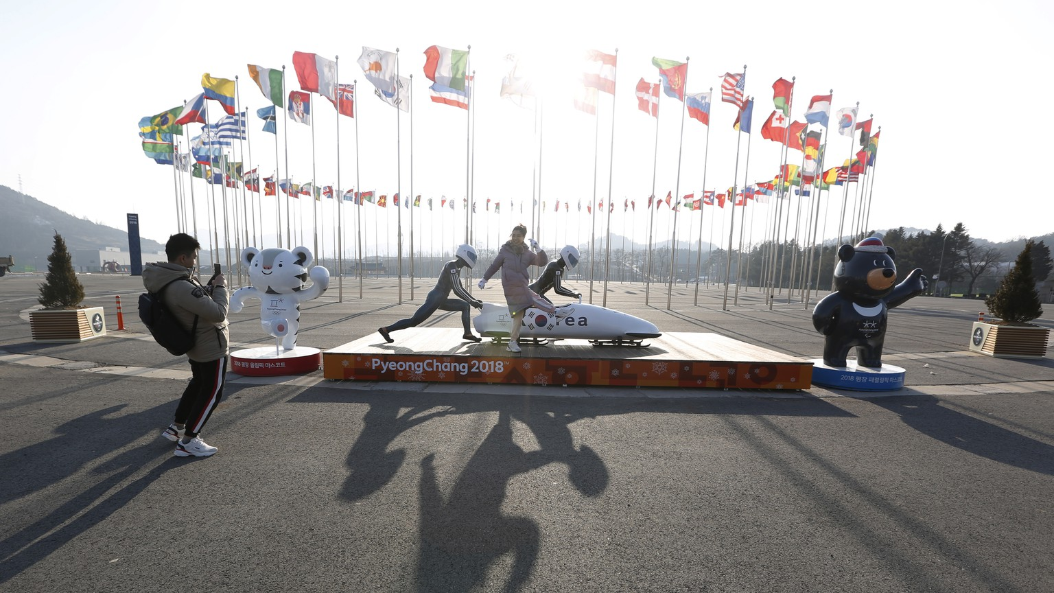 epa07315169 Tourists take picture on what was the so-called Medal Plaza near the Pyeongchang Olympic Stadium (not pictured) which hosted the opening and closing ceremonies of the PyeongChang Winter Olympic and Paralympic Games in PyeongChang, South Korea, 23 January 2019. The PyeongChang 2018 Winter Olympic Games took place from 09 to 25 February 2018.  EPA/JEON HEON-KYUN ATTENTION: This Image is part of a PHOTO SET