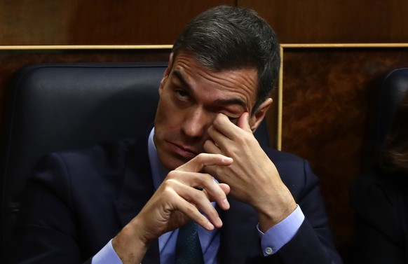 Spain's Prime Minister Pedro Sanchez gestures during a session at Spanish parliament in Madrid, Wednesday, Feb. 13, 2019. Spain's lower house has rejected the ruling Socialist government's 2019 spending proposal, paving the way for a possible call of early elections by Prime Minister Pedro Sanchez. (AP Photo/Manu Fernandez)