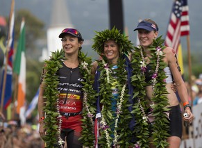 epa04442747 Ironman Women's world champion, Mirinda Carfrae of Australia (C), is flanked by runner up, Daniela Ryf of Switzerland (R) and third placed Rachel Joyce of Britain, at the 2014 Ironman World Championship in Kailua Kona, Hawaii, USA, 11 October 2012. The Ironman competition challenges competitors with a 3.9 km swim, followed by a 180 km bike ride and is finished with a marathon (42.195 km) run.  EPA/Bruce Omori