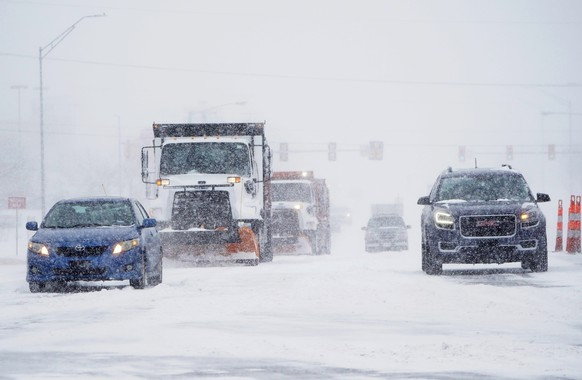 Cars and plows are driven during a winter storm Sunday, Feb. 14, 2021, in Oklahoma City. Snow and ice blanketed large swaths of the U.S. on Sunday, prompting canceled flights, making driving perilous and reaching into areas as far south as Texas