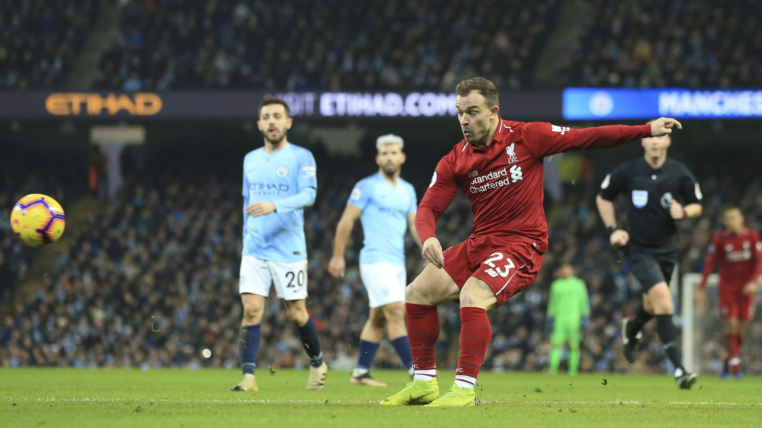Liverpool's Xherdan Shaqiri shots at goal during their English Premier League soccer match between Manchester City and Liverpool at the Ethiad stadium, Manchester England, Thursday, Jan. 3, 2019. (AP Photo/Jon Super)