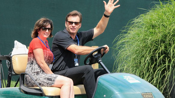 LOUISVILLE, KY - AUGUST 06: Sir Nick Faldo of England rides in a cart with LeslieAnne Wade during a practice round prior to the start of the 96th PGA Championship at Valhalla Golf Club on August 6, 2014 in Louisville, Kentucky.   David Cannon/Getty Images/AFP== FOR NEWSPAPERS, INTERNET, TELCOS & TELEVISION USE ONLY ==