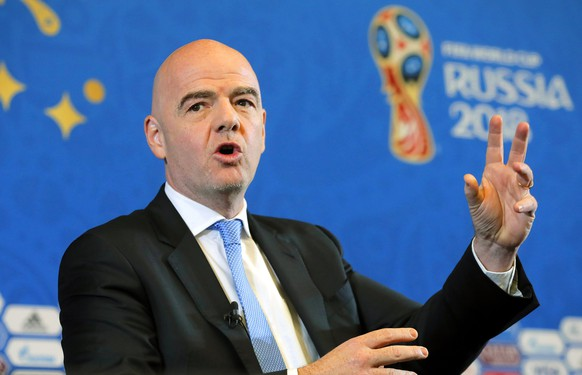 epa06360868 FIFA President Gianni Infantino speaks during a press conference before the Final Draw of the FIFA World Cup 2018 at the State Kremlin Palace in Moscow, Russia, 01 December 2017. The FIFA World Cup 2018 will take place from 14 June until 15 July 2018 in Russia.  EPA/YURI KOCHETKOV