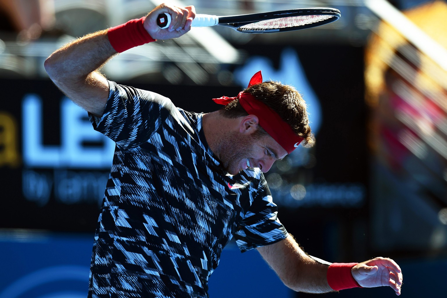 epa04560754 Juan Martin del Potro of Argentina reacts during his quarter final match against Mikhail Kukushkin of Kazakhstan at the Apia International tennis tournament in Sydney, Australia, 15 January 2015.  EPA/DEAN LEWINS AUSTRALIA AND NEW ZEALAND OUT