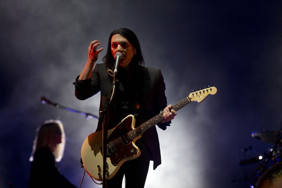 Placebo's Brian Molko performs at the 15th edition of the Vive Latino music festival in Mexico City, Sunday, March 30, 2014. The Vive Latino Festival has become Latin America's biggest Latin rock celebration, with more than 600 bands from more than 50 countries playing on its stage during its 15 year existence.(AP Photo/Rebecca Blackwell)