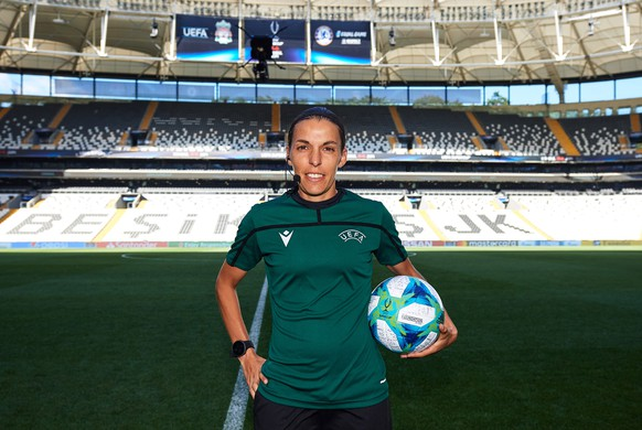 epa07771710 A handout photo made available by the UEFA of main referee Stephanie Frappart of France posing with the official match ball ahead of the UEFA Super Cup Final between Liverpool FC and Chelsea FC at Besiktas Park on August 13, 2019 in Istanbul, Turkey.  EPA/UEFA via Getty Images / ALEX CAPARROS HANDOUT  HANDOUT EDITORIAL USE ONLY/NO SALES