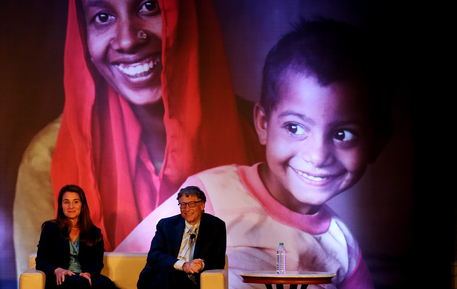 "epa04405692 Founders of the Bill and Melinda Gates Foundation, Melinda Gates and Bill Gates attend an event in New Delhi, India on 18 September 2014. The event was to discuss the work done by the foundation which beleives in ""All lives have equal value"".  EPA/MONEY SHARMA"