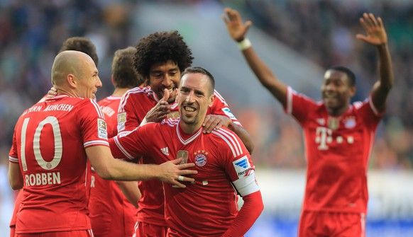 epa04115596 Munich's goal scorer Franck Ribery (C) celebrates his 1-4 goal with teammates Arjen Robben (L-R), Dante and Alaba during the German Bundesliga soccer match between VfL Wolfsburg and Bayern München at the Volkswagen-Arena in Wolfsburg, Germany, 08 March 2014.  (ATTENTION: Due to the accreditation guidelines, the DFL only permits the publication and utilisation of up to 15 pictures per match on the internet and in online media during the match.)  EPA/JENS WOLF