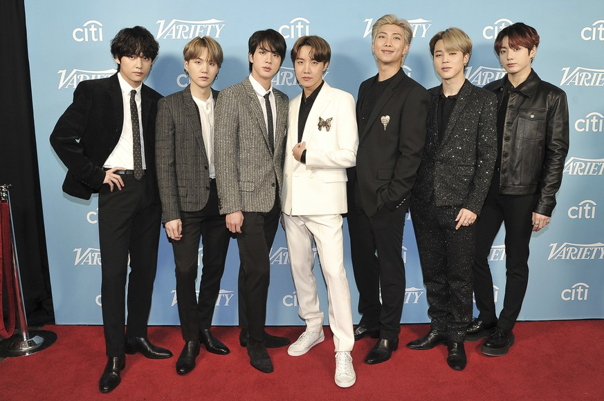FILE - BTS attends the 2019 Variety's Hitmakers Brunch at Soho House in West Hollywood, Calif. on Dec. 7, 2019.  Time magazine named the South Korean group its 2020 Entertainer of the Year.  (Photo by Richard Shotwell/Invision/AP, File) BTS