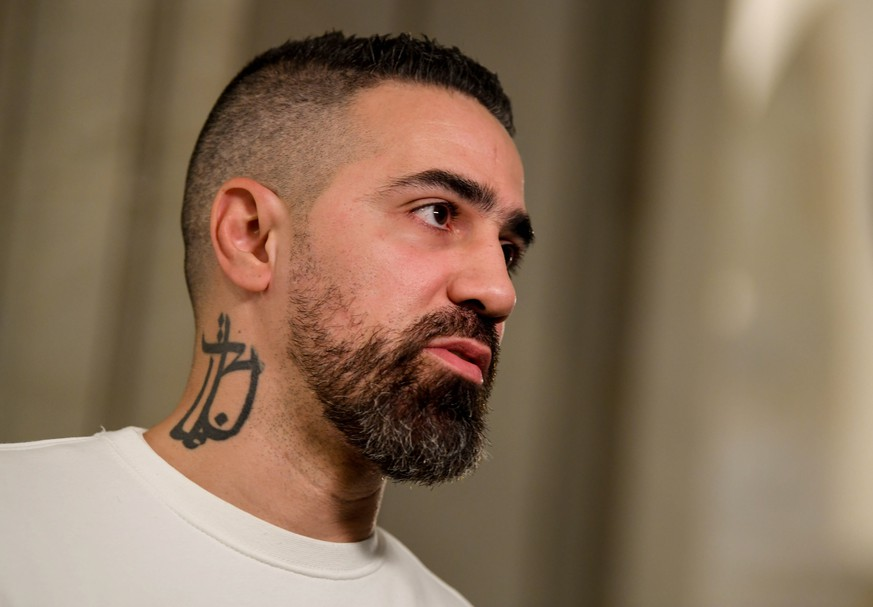 epa07959839 German rapper Bushido at Federal Administrative Court  in Leipzig, Germany, 30 October 2019. Federal Administrative Court  decides on an AfD complaint against the Bushido his album