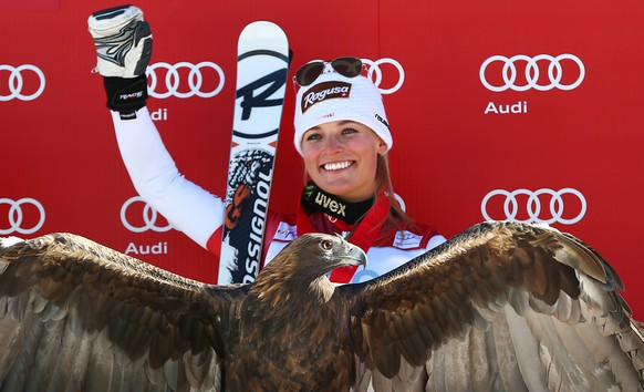 Switzerland's Lara Gut waves from the podium after winning the women's World Cup super-G skiing event, in Beaver Creek, Colo., Saturday, Nov. 30, 2013. (AP Photo/Allesandro Trovati)