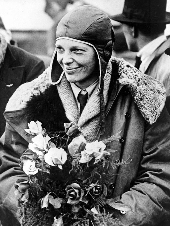FILE - In a June 26, 1928 file photo, American aviatrix Amelia Earhart poses with flowers as she arrives in Southampton, England, after her transatlantic flight on the