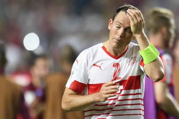 Switzerland's defender Stephan Lichtsteiner looks disappointed after loosing the 2018 Fifa World Cup Russia group B qualification soccer match between Portugal and Switzerland at the Estadio da Luz stadium, in Lisbon, Portugal, Tuesday, October 10, 2017. (KEYSTONE/Laurent Gillieron)