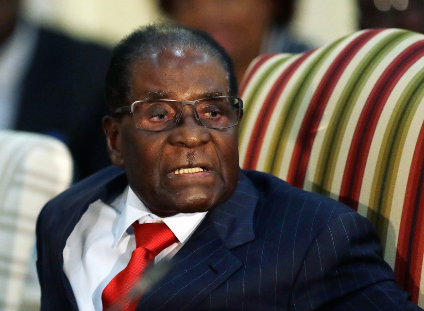 FILE - In this Oct. 3, 2017 file photo, Zimbabwean President Robert Mugabe during a meeting with South African President Jacob Zuma at the Presidential Guesthouse in Pretoria, South Africa. On Friday, Sept. 6, 2019, Zimbabwe President Emmerson Mnangagwa said his predecessor Robert Mugabe, age 95, has died. . (AP Photo/Themba Hadebe, FILE) Robert Mugabe