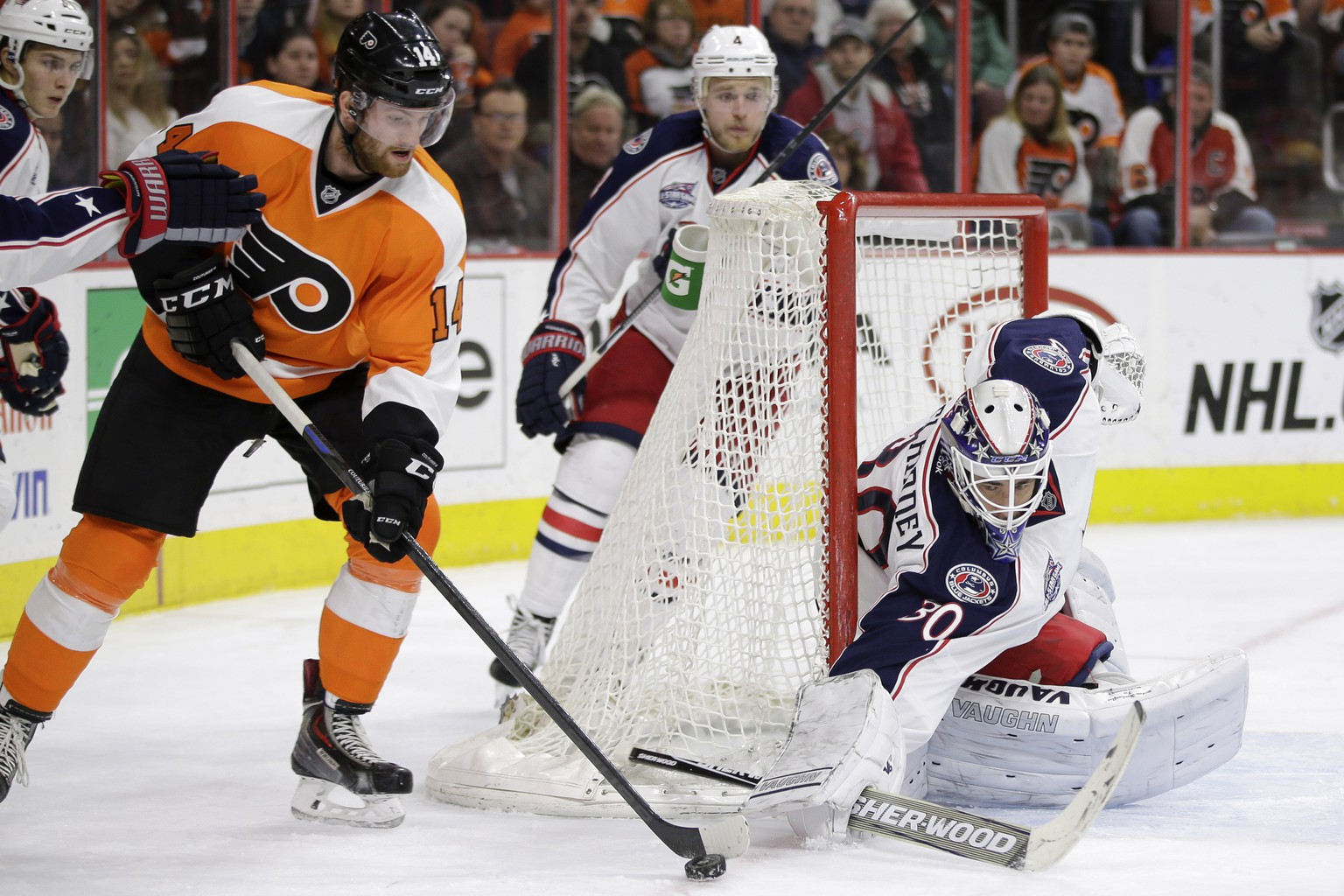 Philadelphia Flyers' Sean Couturier (14) tries to get a shot past Columbus Blue Jackets' Curtis McElhinney (30) during the second period of an NHL hockey game Tuesday, Feb. 17, 2015, in Philadelphia. (AP Photo/Matt Slocum)