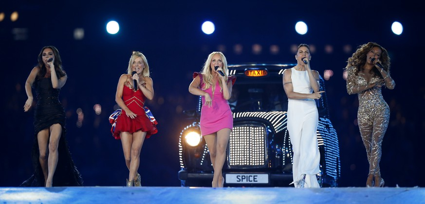 FILE - In this Sunday, Aug. 12, 2012 file photo, British band 'The Spice Girls' perform during the Closing Ceremony at the 2012 Summer Olympics, in London. The Sun newspaper said Saturday Nov. 3, 2018, that the 1990s girl group is about to announce a new tour, but without original member Victoria