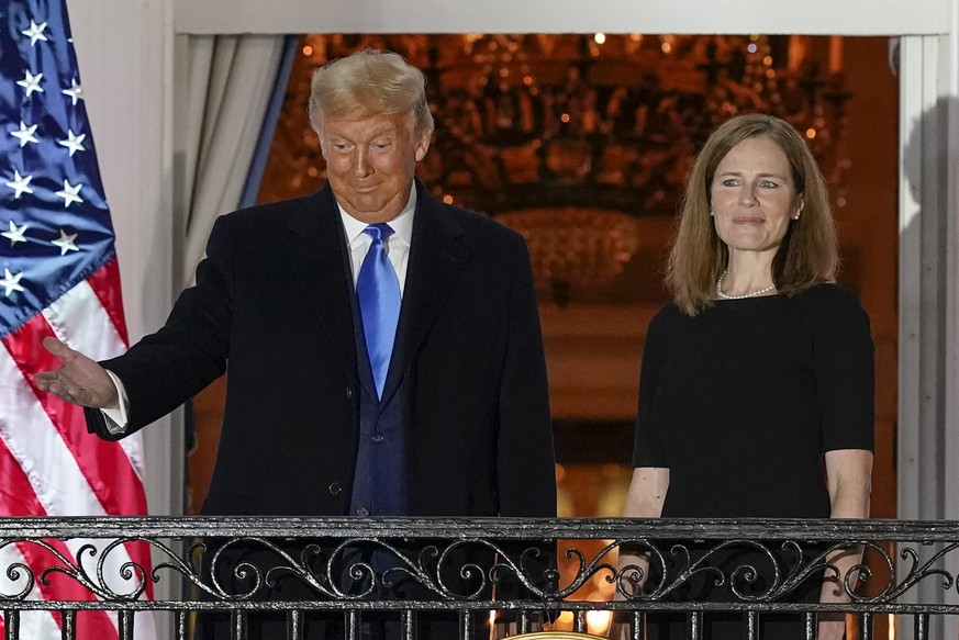 President Donald Trump and Amy Coney Barrett stand on the Blue Room Balcony after Supreme Court Justice Clarence Thomas administered the Constitutional Oath to her on the South Lawn of the White House White House in Washington, Monday, Oct. 26, 2020. Barrett was confirmed to be a Supreme Court justice by the Senate earlier in the evening. (AP Photo/Alex Brandon) Donald Trump