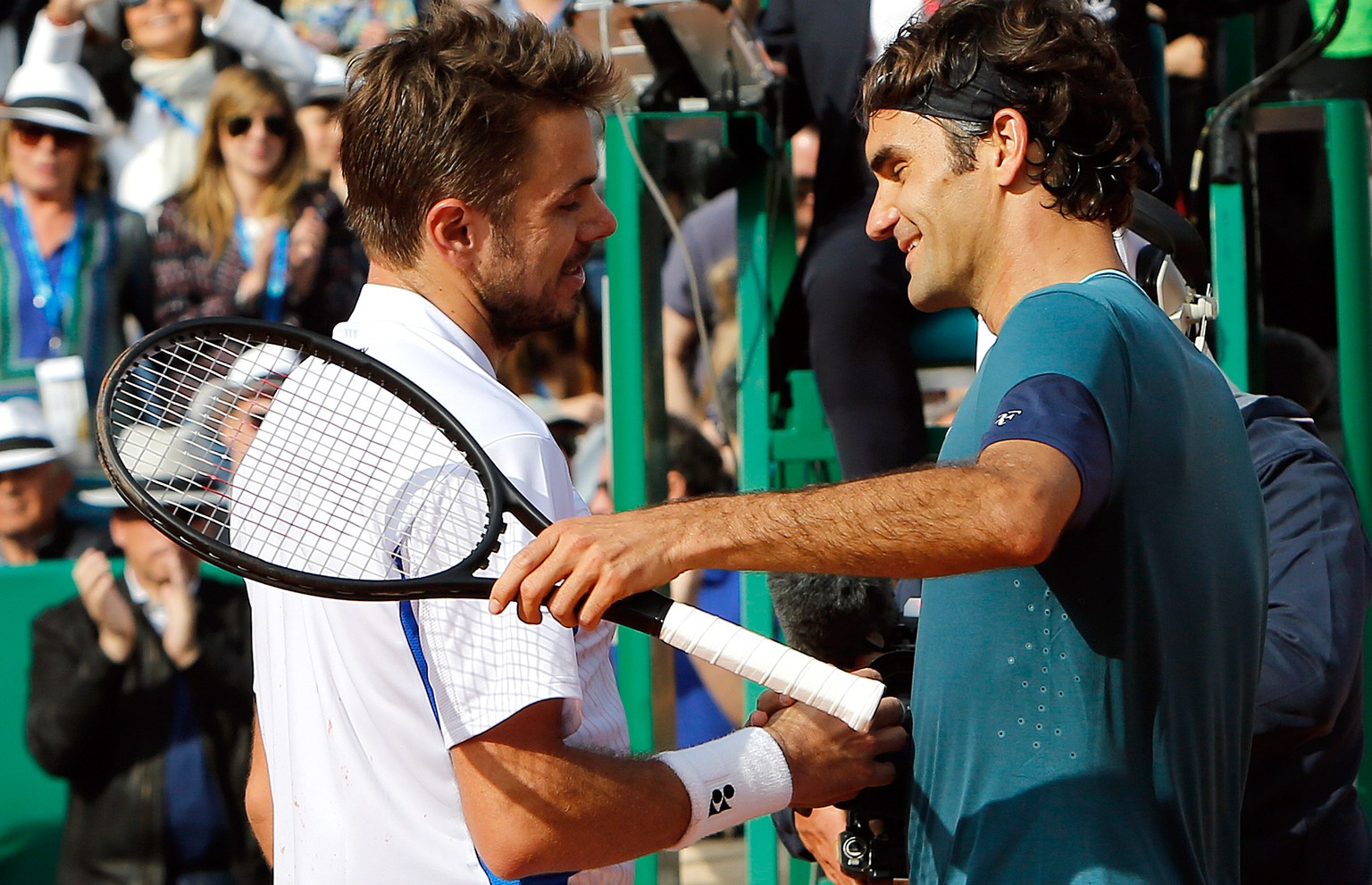 Roger Federer of Switzerland, right, congratulates Stanislas Wawrinka of Switzerland after his victory in the final match of the Monte Carlo Tennis Masters tournament in Monaco, Sunday April 20, 2014. Wawrinka won 4-6, 7-6, 6-2. (AP Photo/Claude Paris)