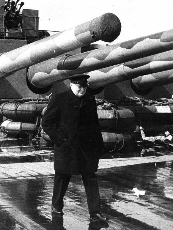 FILE - This is a Aug. 1941 file photo of British Prime Minister Winston Churchill as walks on the deck of H.M.S. Prince of Wales as the British battleship makes her way across the Atlantic to Argentia Bay, off Newfoundland, Canada, during World War II. Churchill Britain's famous World War II prime minister died fifty years ago on January 24 1965. (AP Photo, File)