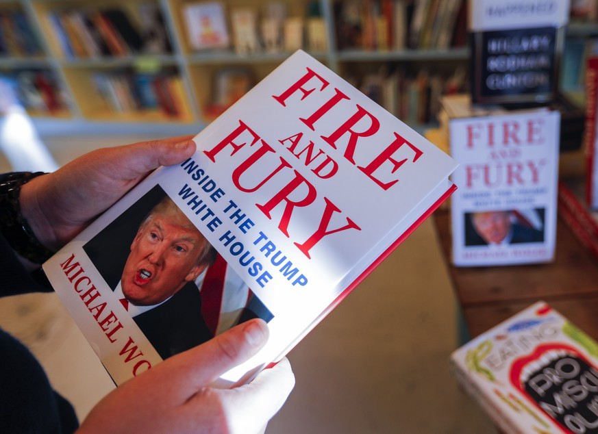 epaselect epa06419286 Michael Wolff's book 'Fire and Fury' about the Trump White House for sale at the Little Shop of Stories bookstore in Decatur, Georgia, USA 05 January 2018. The book's release came four days early amid threats of lawsuits from President Trump and his legal team.  EPA/ERIK S. LESSER