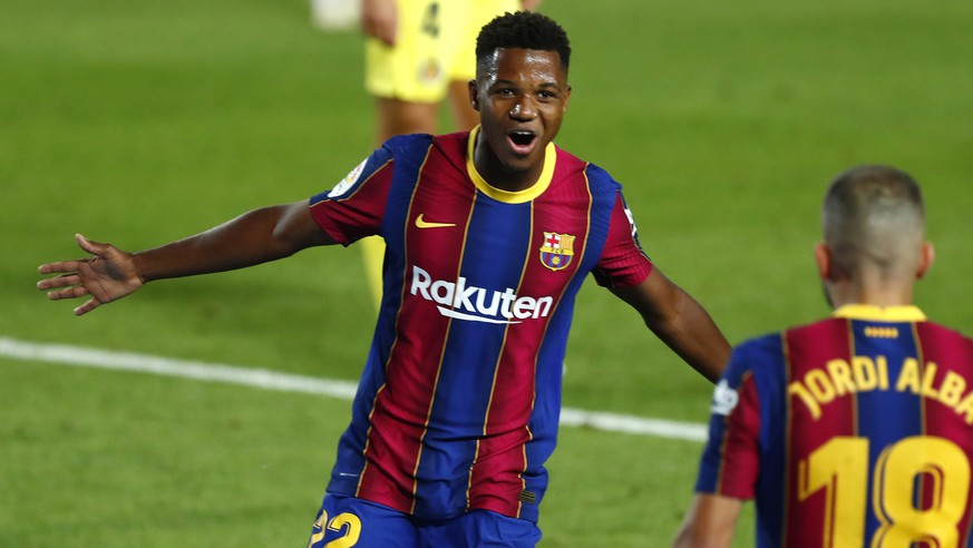 Barcelona's Ansu Fati celebrates scoring the opening goal during the Spanish La Liga soccer match between FC Barcelona and Villareal FC at the Camp Nou stadium in Barcelona, Spain, Sunday, Sept. 27, 2020. (AP Photo/Joan Monfort) Ansu Fati