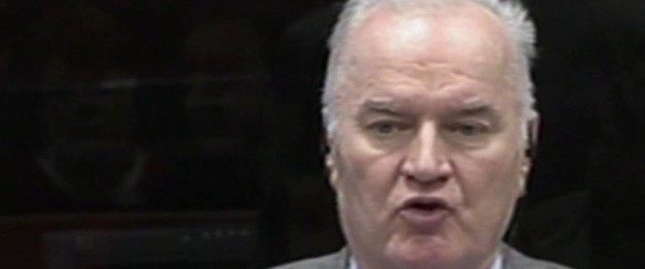 "In this image taken from video former Bosnian Serb army commander Gen. Ratko Mladic speaks to the court during his appearance at the Yugoslav war crimes tribunal Tuesday Jan. 28, 2014 in the Hague Netherlands. Mladic slammed the United Nations' Yugoslav war crimes tribunal Tuesday as a ""satanic court"" and refused to testify as a defense witness for his former political master, Radovan Karadzic.  A courtroom reunion of the two alleged chief architects of Serb atrocities during Bosnia's 1992-95 war lasted only about an hour as Mladic repeatedly told judges he would not answer former Bosnian Serb President Karadzic's questions, citing ill health and an unwillingness to risk incriminating himself.(AP Photo/ICTY, Via Associated Press Television) TV OUT"
