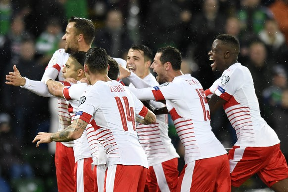 Switzerland's soccer players celebrate the 0:1 scoring by Switzerland's defender Ricardo Rodriguez, during the 2018 Fifa World Cup play-offs first leg soccer match Northern Ireland against Switzerland at Windsor Park, in Belfast, Northern Ireland, Britain, Thursday, November 9, 2017. (KEYSTONE/Laurent Gillieron)