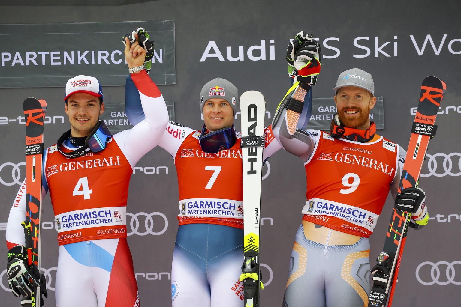 France's Alexis Pinturault, center, winner of an alpine ski, men's World Cup giant slalom, celebrates on the podium with second-placed Switzerland's Loic Meillard, left, and third-placed Norway's Leif Kristian Nestvold Haugen, in Garmisch Partenkirchen, Germany, Sunday, Feb. 2, 2020. (AP Photo/Marco Trovati)