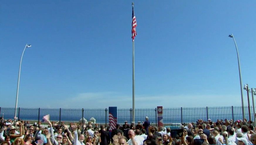 epa04883495 A screen grab from a video feed provided by the US Department of State shows people cheering after the US flag was raised at the reinaugurated US embassy in Havana, Cuba, 14 August 2015. The embassy was closed in 1961 when the Eisenhower administration severed diplomatic ties with the Cuban government. The new US embassy will be in the same building that housed the mission when the stars-and-stripes were last lowered 54 years ago - overlooking the iconic Malecon seaside esplanade. Cuba formally opened its embassy in Washington in July 2015, as Washington and Havana take another step in repairing their long-fractured ties.  EPA/US DEPARTMENT OF STATE/HANDOUT BEST QUALITY AVAILABLE. HANDOUT EDITORIAL USE ONLY/NO SALES