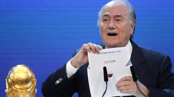 FILE - In this Thursday, Dec.2, 2010 file photo FIFA President Sepp Blatter announces Qatar to host the 2022 soccer World Cup in Zurich, Switzerland. FIFA has cleared Russia and Qatar of any wrongdoing in their winning bids for the next two World Cups. (AP Photo/Michael Probst)