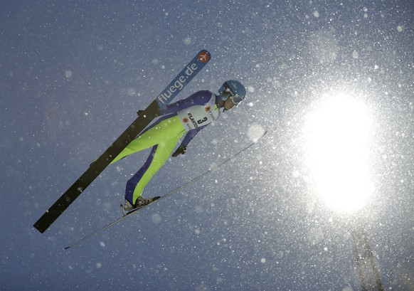 China's Chang Xinyue makes an attempt during women's Normal Hill ski jumping competition at the 2017 Nordic Skiing World Championships in Lahti, Finland, Friday, Feb. 24, 2017. (AP Photo/Matthias Schrader)