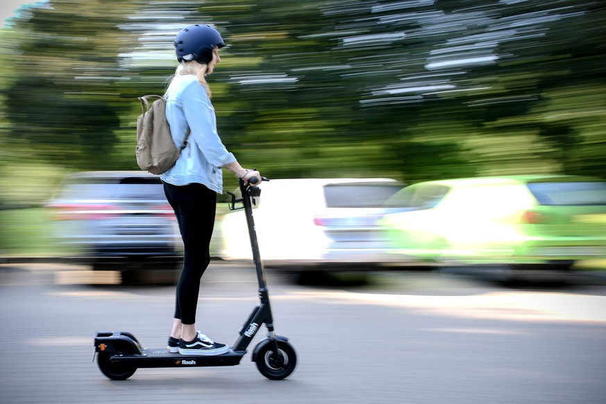 epa07627038 A woman rides an CIRC e-scooter (former FLASH) in Herne, Germany, 05 June 2019. Even before electric pedal-scooters are allowed nationwide on 15 June, a first provider will start a rental service in the Ruhr area. In the city of Herne, several dozens of electric scooters are to be put on the road from 05 June with the permission of local authorities.  EPA/SASCHA STEINBACH
