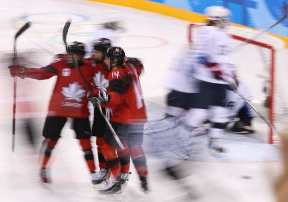 epa06527035 Canada players celebrate a goal against the USA during a preliminary Women's Ice Hockey match between USA and Canada at the Kwandong  Hockey Centre during the PyeongChang Winter Olympic Games 2018, in Gangneung, South Korea, 15 February 2018.  EPA/JAVIER ETXEZARRETA