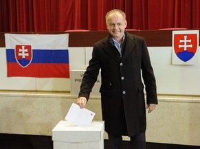 Candidate Andrej Kiska casts his ballot for the Slovak presidential election in Poprad, 300 kilometres (186 miles)  northeast of Bratislava, on Saturday, March 15, 2014. Slovak citizens are choosing among 14 candidates to succeed Ivan Gasparovic in a largely ceremonial post. The 51-year-old successful businessman-turned philanthropist Kiska is Prime Minister's Robert Fico's major challenger. (AP Photo/CTK, Tomas Halasz) SLOVAKIA OUT