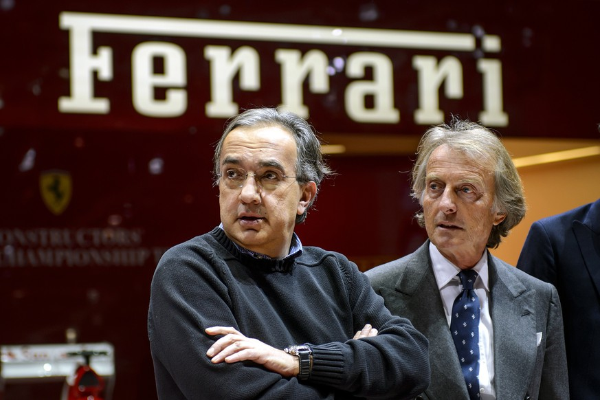 (FILES) A file photo taken on March 5, 2013 shows Italian car giant Fiat CEO Sergio Marchionne (L) and Ferrari President Luca di Montezemolo standing at the Ferrari booth of the Geneva International Motor Show. Montezemolo is close to leaving the supercar maker because of a clash over strategy with the brand's parent, Fiat, according to people familiar with the matter. Montezemolo said on September 8 at the Italian Grand Prix that reports he was to step down later this year were premature. The 67-year-old said he had a contract for three years and that he would be the one to say when he is leaving. AFP PHOTO / FABRICE COFFRINI