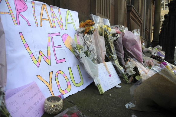 Flower tributes at St Ann's square, Manchester, England Tuesday May 23, 2017. The Islamic State group claimed responsibility Tuesday for the suicide attack at an Ariana Grande show that left more than 20 people dead as young concertgoers fled, some still wearing the American pop star's trademark kitten ears and holding pink balloons. (AP Photo/Rui Vieira)