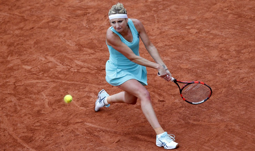 Timea Bacsinszky of Switzerland returns the ball to Netherlands' Kiki Bertens during their quarterfinal match of the French Open tennis tournament at the Roland Garros stadium, Thursday, June 2, 2016 in Paris.  (AP Photo/Christophe Ena)