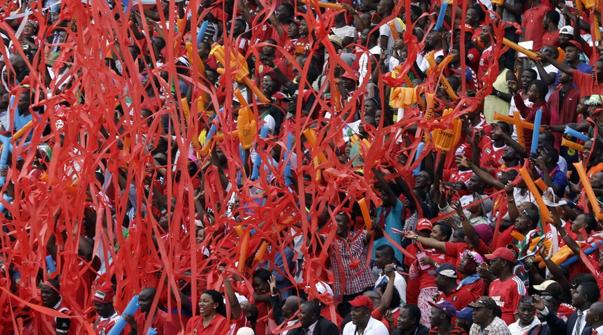 Soccer supporters watch the opening African Cup of Nations Group A soccer match between Equatorial Guinea and Congo, in Bata, Equatorial Guinea, Saturday, Jan. 17, 2015. (AP Photo/Themba Hadebe)
