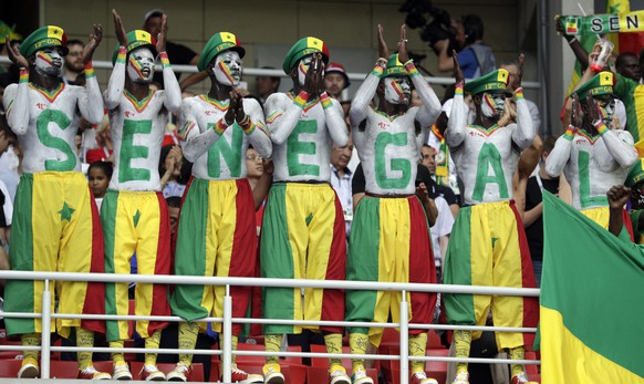 Senegal's fans support their team during the group H match between Poland and Senegal at the 2018 soccer World Cup in the Spartak Stadium in Moscow, Russia, Tuesday, June 19, 2018. (AP Photo/Andrew Medichini)