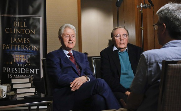 FILE - In this Monday, May 21, 2018, file photo, former President Bill Clinton, left, and author James Patterson speak during an interview about their novel,
