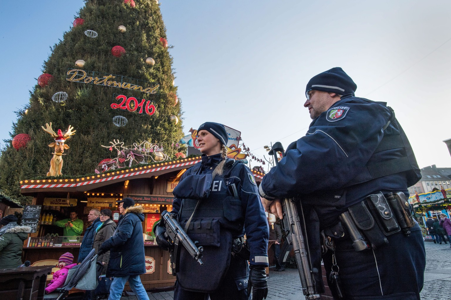 epa05683252 Police officers patrol the Christmas market in Dortmund, Germany, 20 December 2016. Police are stepping up security measures at markets across Germany after 12 people were killed and at least 48 injured when a truck ploughed into a busy Christmas market in Berlin, 19 December. Authorities are investigating the incident as a 'possible terrorist attack'.  EPA/BERND THISSEN
